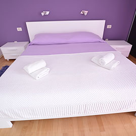 Purple double bed